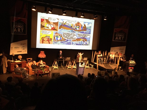 Artist Charlie Adlard attempts to convince the audience Asterix is better than Tintin by wearing a silly hat and kicking Snowy! (It's a puppet...)
