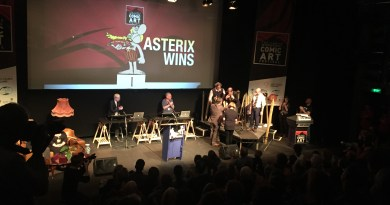 """Simon Guy from Lancaster University presents the Asterix team with medals, adied by Festival Director Julie Tait. The Tintin team got medals too (because it """"was cheaper to buy them in bulk"""", Julie explained)."""
