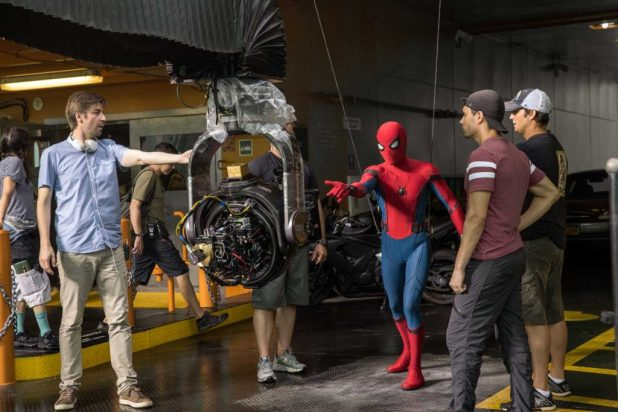 Director Jon Watts with cast and crew on the set of Columbia Pictures' SPIDER-MAN: HOMECOMING.
