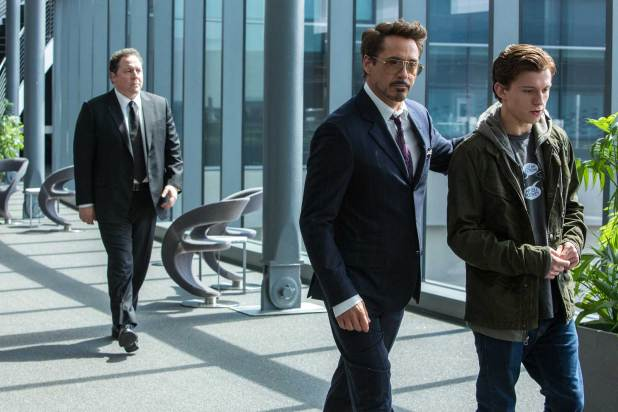 Tony Stark (Robert Donwey Jr.) with Peter Parker (Tom Holland)