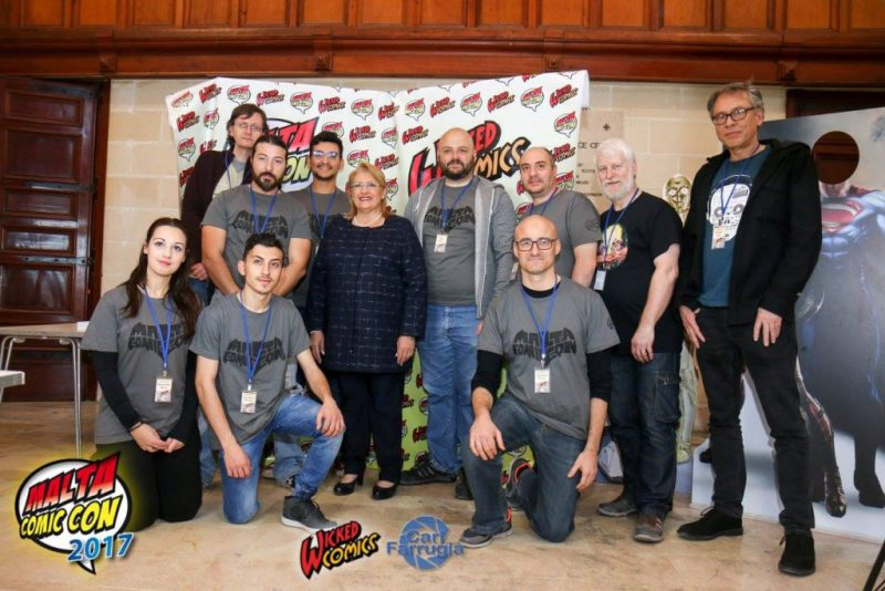 Pictured: Wicked Comics with her excellency Marie-Louise Coleiro Preca [ President of Malta ] — with Samantha Abela, Mark Ellul, Christian Debono, Marie-Louise Coleiro Preca, Fabio Agius, Chris Le Galle, Christopher Muscat and Tim Perkins at Mediterranean Conference Centre.