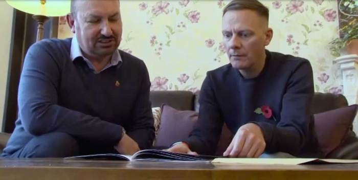 Actor Antony Cotton, ambassador for Armed Forces charities Help For Heroes and SSAFA, formerly known as Soldiers, Sailors, Airmen and Families Association, presents Philip Livingstone with a print edition of Fantastic Forces - The Longest Road. Image: Forces News