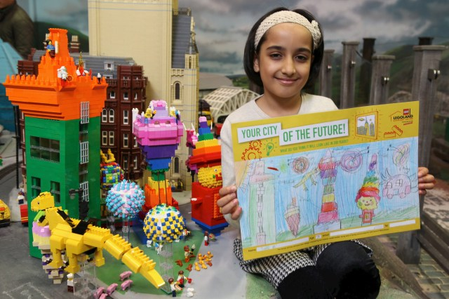 """Saira Ali with her winning entry in a nationwide """"Cities of the Future"""" competition, which been brought to life in a giant LEGO model, built by a Master Model Builder."""
