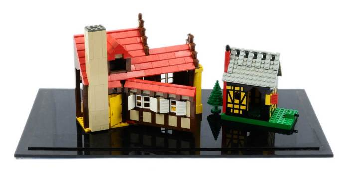 Rare Lego Buildings from the personal collection of Daniel Krentz (1937-2016) from his home in Denmark. Daniel was a well known Lego designer responsible for such classics as 375 Castle and 6074 Black Falcons Fortress. The two buildings are contained loose in a perspex case and plinth and come with a certificate of authentication, previously auctioned by Fairybricks in 2017