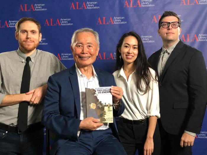 The They Called Us Enemy team with the Asian/Pacific American Award for Young Adult Literature. Photo: Leigh Walton