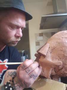 "Artist Neil Blackbird Sims at work on a sculpt of the Mekon he created ""just for fun"""