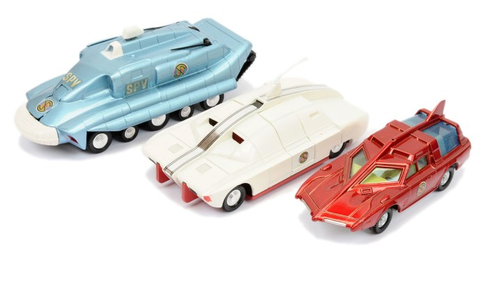 """Dinky """"Captain Scarlet"""", a group that includes a Spectrum Pursuit Vehicle - blue, white bumper, black rubber tracks, cast hubs, with missile; Maximum Security Vehicle (1st issue) - white, red base and interior, plastic aerial, cast spun hubs, with radiation box (missing side stripes); Spectrum Patrol Car - metallic red, blue tinted windows, white base, cast hubs (missing aerial)"""