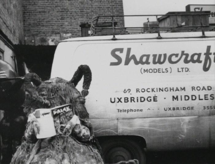 A Dalek fan reading a Dalek annual beside a Shawcraft Models van in the 1960s