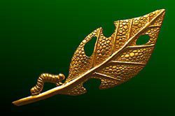 Caterpillar and Leaf Brooch designed by Tim White. An 18ct gold brooch, two inches in size, of a caterpillar nibbled leaf