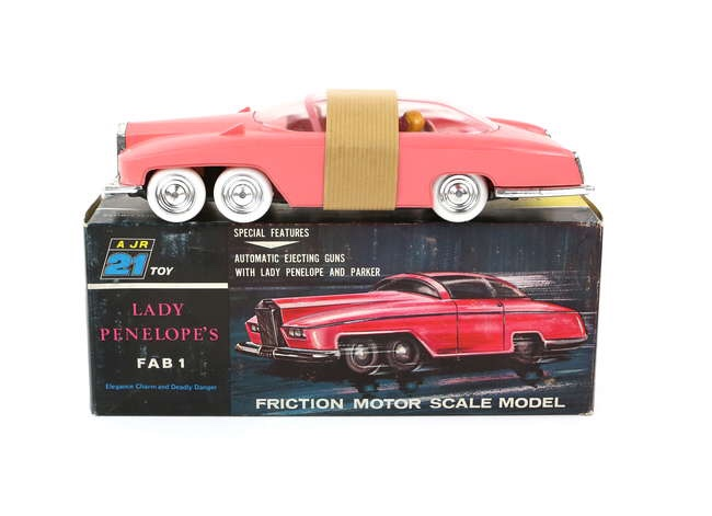 Thunderbirds JR 21 Toy Lady Penelope`s FAB 1, in pink plastic with friction drive, chrome wheels, plastic figures and white tyres, in original box with inner packaging and brown strip protecting roof from wear. Box dimensions 11 x 28 x 8 cm. Image: Ewbanks