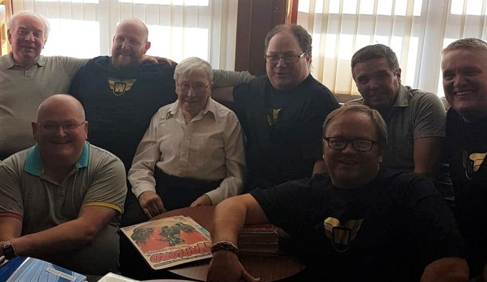 Colin Noble (centre) with artist Ian Kennedy and others at the third Commando and British Comics Swap Meet in 2018