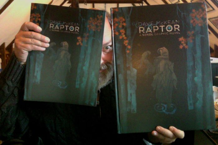 Dave McKean with copies of both the paperback and deluxe, oversized hardcover edition of Raptor