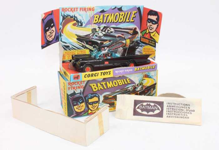 A Corgi Toys 1st issue 267 Batmobile without toe hook in gloss black body 'Bat' logo on doors, with gold cast hubs with red 'Bat' logos. The model has blue-tinted windows which are undamaged with 'Batman and Robin' figures inside