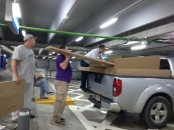 Jay supervising the loading Ikea tables and cabinets for classroom