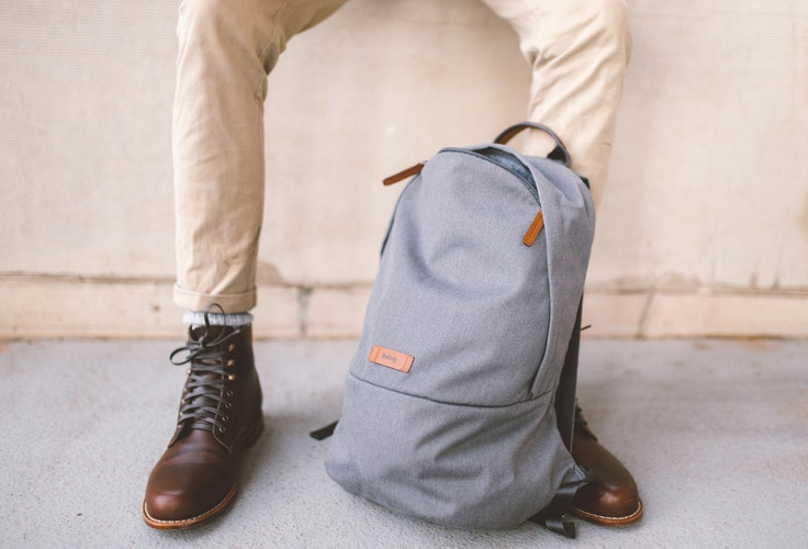 A picture of a student with a backpack.