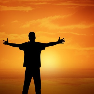A man facing the setting sun.