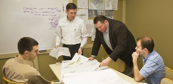 peter, john and staff reviewing plans