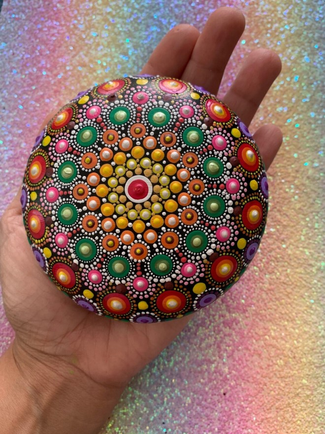 Handmade rock with handpainted mandala design