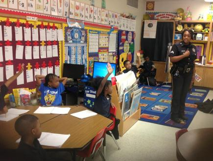 Photo contest winner - Sgt. Nekia Tillotson speaks to children at a local school about the importance of calling 911.