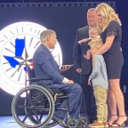 The family of fallen officer, Mitchell Penton receiving his Star of Texas Award.