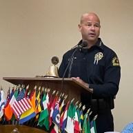 Dallas Police Chief Eddie Garcia offering words of encouragement and congratulating Senior Corporal Tamez.