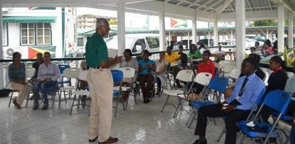 CEO od Amy's Pomeroon Foods Inc. Mr Louis Holder engaging those attending the coffee tasting exercise .JPG-june16