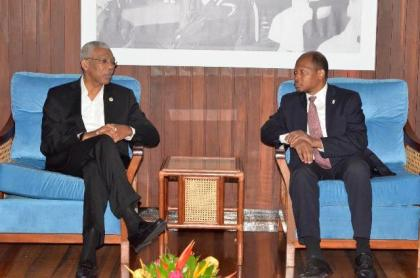 President David Granger conversing with Ambassador George Talbot at the Ministry of the Presidency