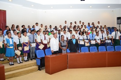 Minister of Indigenous Peoples' Affairs Sydney Allicock with the graduting students of the 2016 batch of Hinterland Scholarship Programme