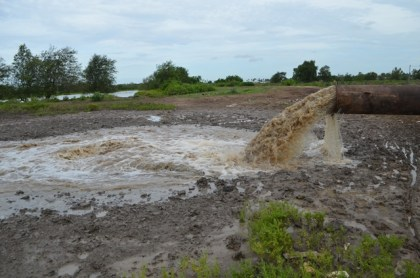 Water being drained by one of four mobile pumps at Trafalgar outfall, Region Five