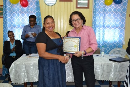 First Lady, Mrs. Sandra Granger presents one of the participants with her Certificate, signifying her successful completion of the Self Reliance and Success in Business Workshop.