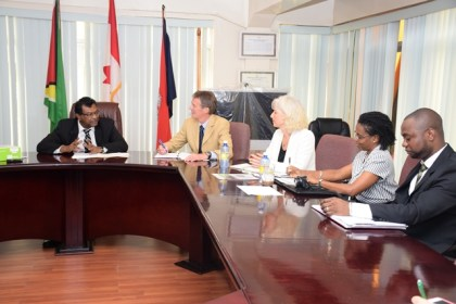 Minister of Public Security Khemraj Ramjattan in discussion with Canadians of the Justice Education Society and Director of GFSL Delon France (far right)