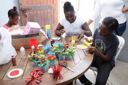 Children of Mocha police youth group making recycled craft