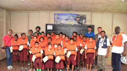 Nursery and Primary students who received lifejackets from the Maritime Administration Department, also in the photo are representatives of Oldendorff Carriers