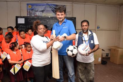 Lurleen Williams, Community Council Member in Charge of Sport, receiving sports equipment from Oldendorff Carriers representatives