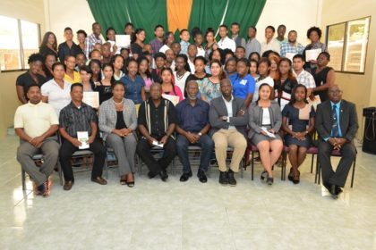Technical Facilitator to the Minister of Education, Mr. Vincent Alexander and Presidential Advisor on Youth Empowerment, Mr. Aubrey Norton with facilitators and participants at the graduation ceremony of the second of eight  Youth Leadership Training programmes.