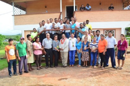 Prime Minister Moses Nagamootoo and Ministers Valerie Garrido Lowe, Sydney Allicock and Ronald Bulkan pose with the graduates after the official ceremony.