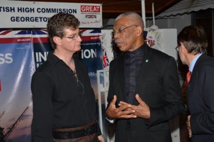 President David Granger makes a point to British High Commissioner to Guyana, Mr. Greg Quinn at the reception, which was held to mark Britain's Queen Elizabeth's 90th birthday.