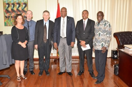 Minister of State, Mr. Joseph Harmon (centre) is flanked by, from left; Ms. Kimberly Cook, Mr. Volker Bohn, Mr. George Norwood, Dr. Gavin Melville and Apostle Claude Brooks, at the Ministry of the Presidency.