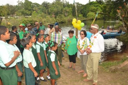 President Granger, First Lady, Mrs. Sandra Granger and Minister of Social Cohesion, Ms. Amna Ally enjoys a performance by the students of the St. Francis Primary School, who welcomed them with a song upon their arrival into the village.