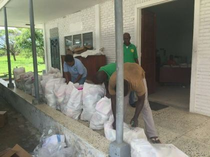 CDC officials preparing hampers for distribution in Moraikobai over the weekend.