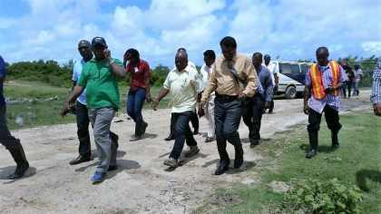 Minister of Citizenship, Winston Felix and Minister of Public Security,  Khemraj Ramjattan arriving at the Trafalgar pump station, Region Five