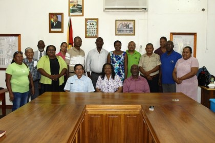 Minister of Social Protection Volda Lawrence and Minister within the Ministry, Keith Scott, Region 9 Chairman, Brian Allicock, Member of Parliament, Desmond Adams, Chief Social Services Officer, Ricardo Banwarie and Mayor of Region 9, Carlton Beckles flanked by members of the Region 9 Board of Guardians