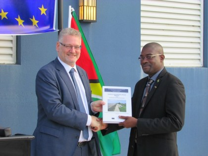 Minister of Public Infrastructure, David Patterson (right), receives the Coastal Engineering Design Manual for Guyana Sea and River Defences from European Union Ambassador, Jernej Videtič