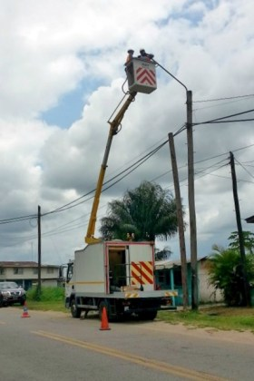 Officials from the Guyana Energy Agency installing the energy efficient streetlights