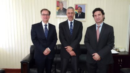 Minister of Business, Dominic Gaskin (C) with Dr. Christophe Bernasconi (L) and Ignacio Goicoechea (R)