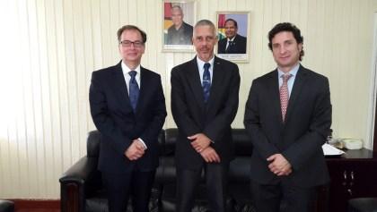 Minister of Business, Dominic Gaskin (C) with Dr. Christophe Bernasconi (L) and Ignacio Goicoechea (R)