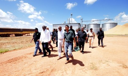 President David Granger, Barbados Prime Minister Freundel Stuart and the visiting delegation being given a guided tour of the Santa Fe Mega farm by Assistant Farm Manager, Christopher Moses