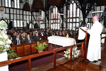 President David Granger, Prime Minister, Mr. Moses Nagamootoo and Speaker of the National Assembly, Dr. Barton Scotland are seated in the front pew at the funeral service for the late Bishop Randolph George