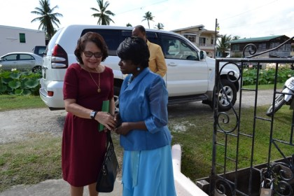 Pastor Victorine Kellman of the Tabernacle Moravian Church greets First Lady, Mrs. Sandra Granger on her arrival at the church for the opening service of the Third International Moravian Women's Conference.