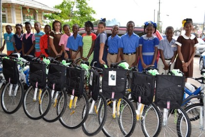 Some of the top students in the Upper Demerara – Upper Berbice Region display their bicycles and backpacks